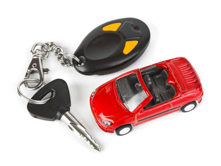 Toy car and keys isolated on white background photo