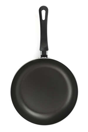 Black frying pan isolated on white background photo