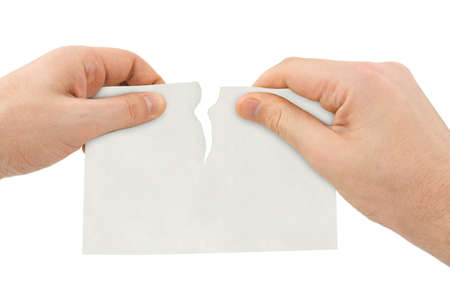 torned: Hands tear paper isolated on white background