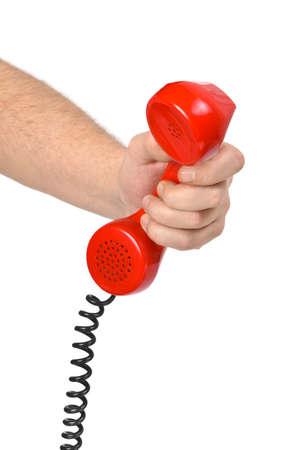 Hand and telephone isolated on white background photo
