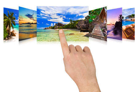 scrolling: Hand scrolling summer beach images - nature and tourism concept (my photos) Stock Photo