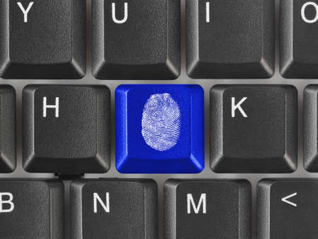 Computer keyboard with fingerprint - security concept Stock Photo - 9856167