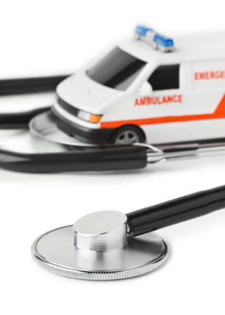 Stethoscope and toy ambulance car isolated on white background photo