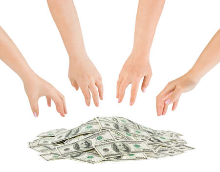 hand reaching: Hands and money heap isolated on white background Stock Photo