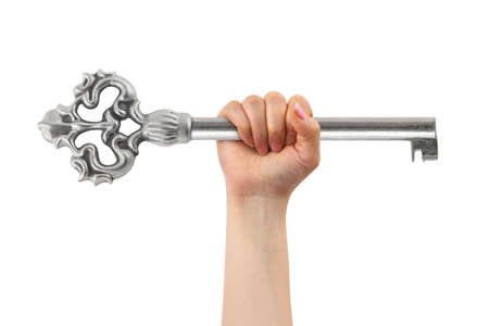 Hand and big key isolated on white background photo