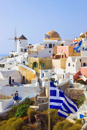 Santorini view (Oia) and greek flag - vacation background photo