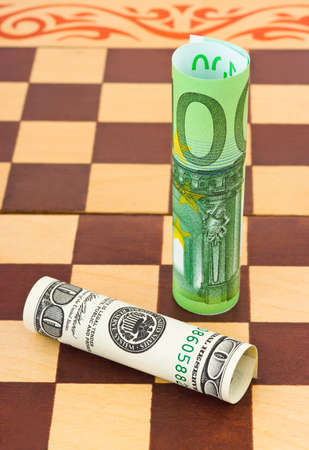 Dollar and euro on chess board - business concept background photo