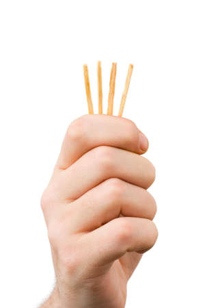 shorter: Hand and matches - draw lots isolated on white background Stock Photo
