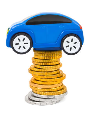 Toy car and stack of coins isolated on white background photo
