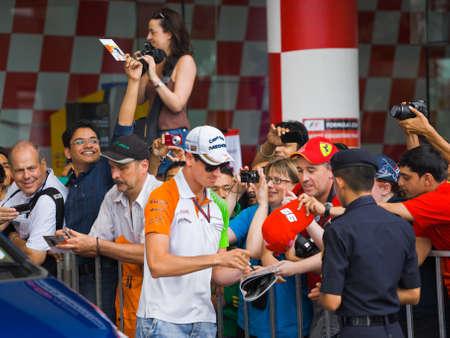 gp: SEPANG, MALAYSIA - APRIL 10: Adrian Sutil (team Force India) at the autograph session on Formula 1 GP, April 10 2011, Sepang, Malaysia