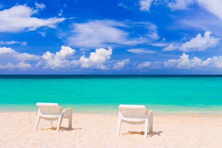 caribbean climate: Chairs on tropical beach - abstract vacations background Stock Photo