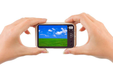 nature picture: Camera with nature picture in hands isolated on white background