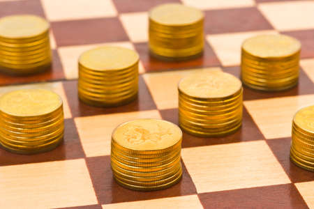 Money on chess board - concept business background photo