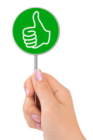 Thumb sign in hand isolated on white background photo