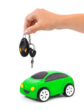 Hand with keys and car isolated on white background Stock Photo - 10078217