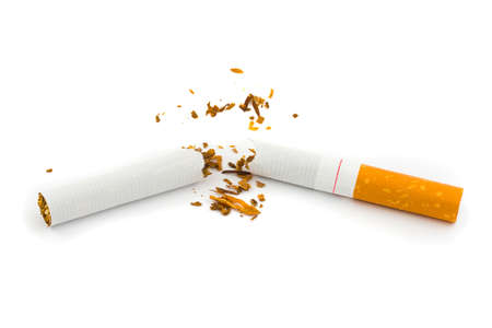 Broken cigarette isolated on white background photo