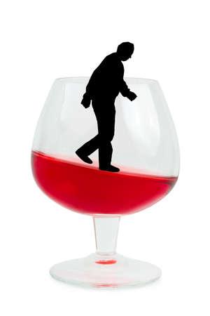 Wine glass and alcoholic man isolated on white background photo