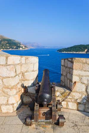 croatia dubrovnik: Retro cannon at Dubrovnik, Croatia - architecture background