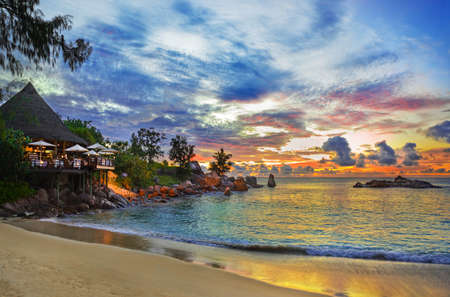 seychelles: Cafe on tropical beach at sunset - nature background