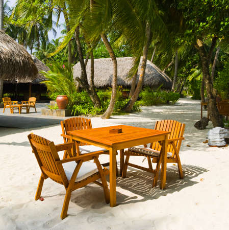 Cafe on the beach of tropical island - vacation background photo