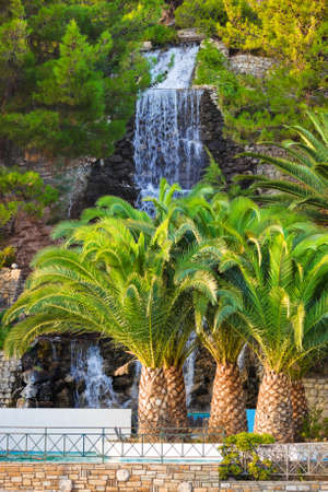 waterfall in the city: Waterfall in Loutraki, Greece - nature travel background
