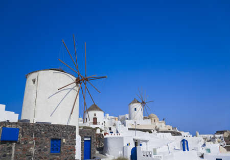 Windmill in Oia at Santorini island, Greece - vacation background photo