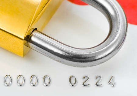 bancomat: Lock and credit card - business security background
