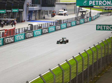 bolide: SEPANG, MALAYSIA - APRIL 8: Jarno Trulli (team Lotus) at first practice on Formula 1 GP, April 8 2011, Sepang, Malaysia