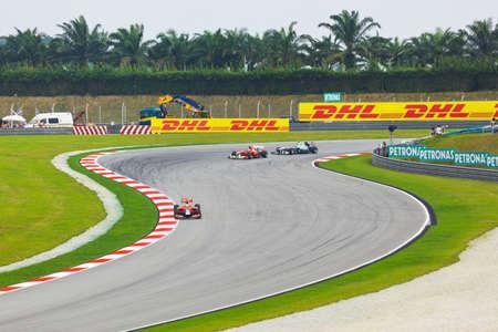 race track: SEPANG, MALAYSIA - APRIL 9: Cars on track at qualification of Formula 1 GP, April 9 2011, Sepang, Malaysia