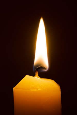 memorial candle: Macro of burning candle isolated on black background Stock Photo