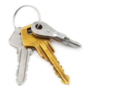 Bunch of keys isolated on white background photo