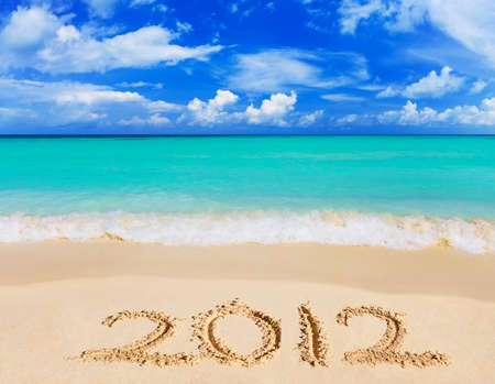 Numbers 2012 on beach - concept holiday background Stock Photo