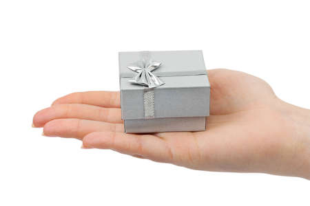 Hand and gift isolated on white background photo