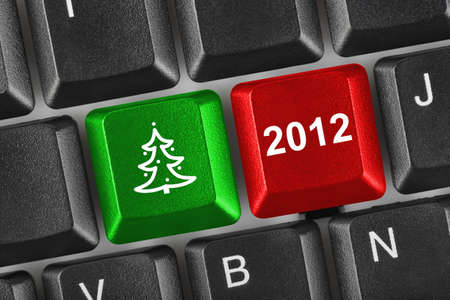 Computer keyboard with Christmas keys - holiday concept Stock Photo - 11270560