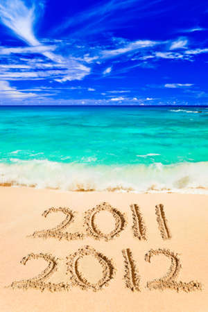 maldives island: Numbers 2012 on beach - concept holiday background Stock Photo