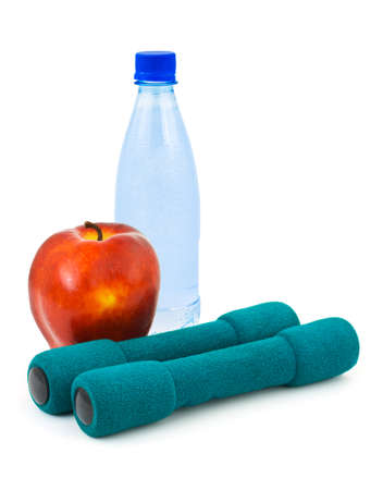 Apple, water and dumbbells isolated on white background photo