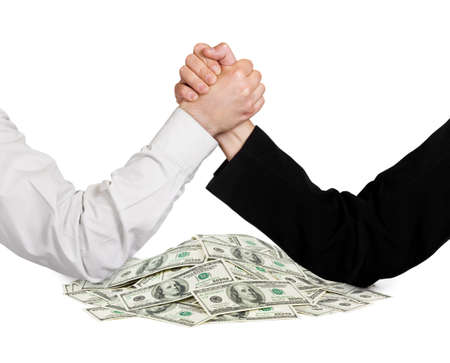 negotiation business: Two wrestling hands and money isolated on white background
