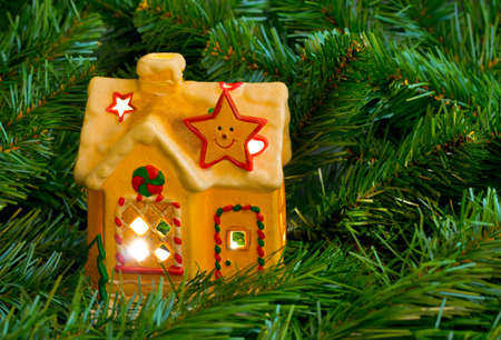 close up chimney: Lighting house and christmas tree - abstract holiday background