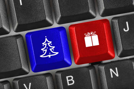 Computer keyboard with Christmas keys - holiday concept photo