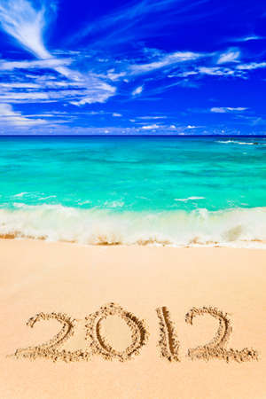 Numbers 2011 on beach - concept holiday background photo