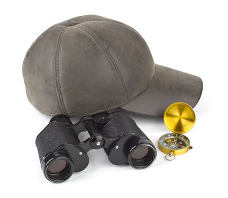 Binoculars, compass and cap - travel concept Stock Photo - 11270612