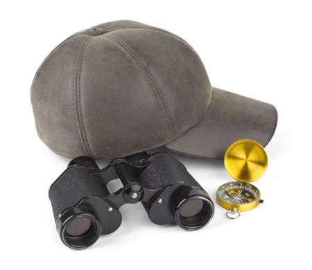 Binoculars, compass and cap - travel concept photo