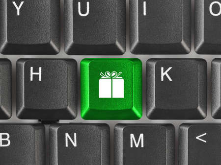 Computer keyboard with gift key - business background photo