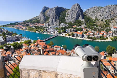 Binoculars and town Omis in Croatia - travel background Stock Photo - 11438098
