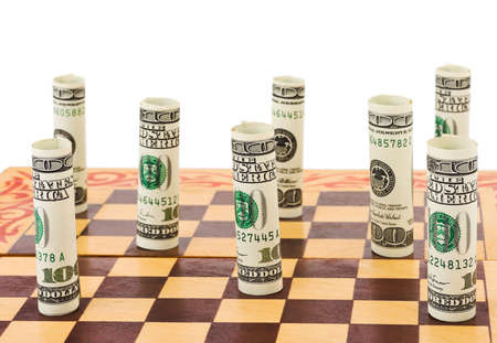 wealth management: Money on chess board isolated on white background Stock Photo