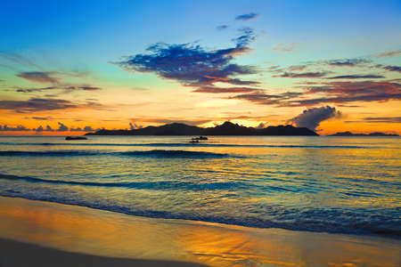 vue: Tropical island at sunset - nature background Stock Photo