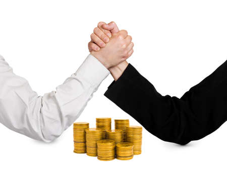 negotiation business: Two wrestling hands and coins isolated on white background