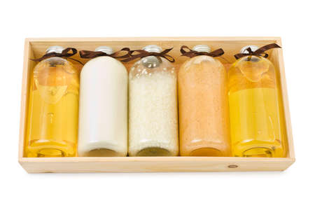 Bottles of spa oil and salt in box isolated on white background photo