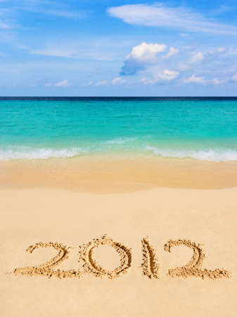 Numbers 2012 on beach - concept holiday background photo