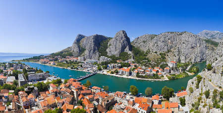 Panorama of town Omis in Croatia - travel background photo